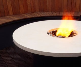 2005 Design and Decoration Award winner - circular seating area around a table with a firepit