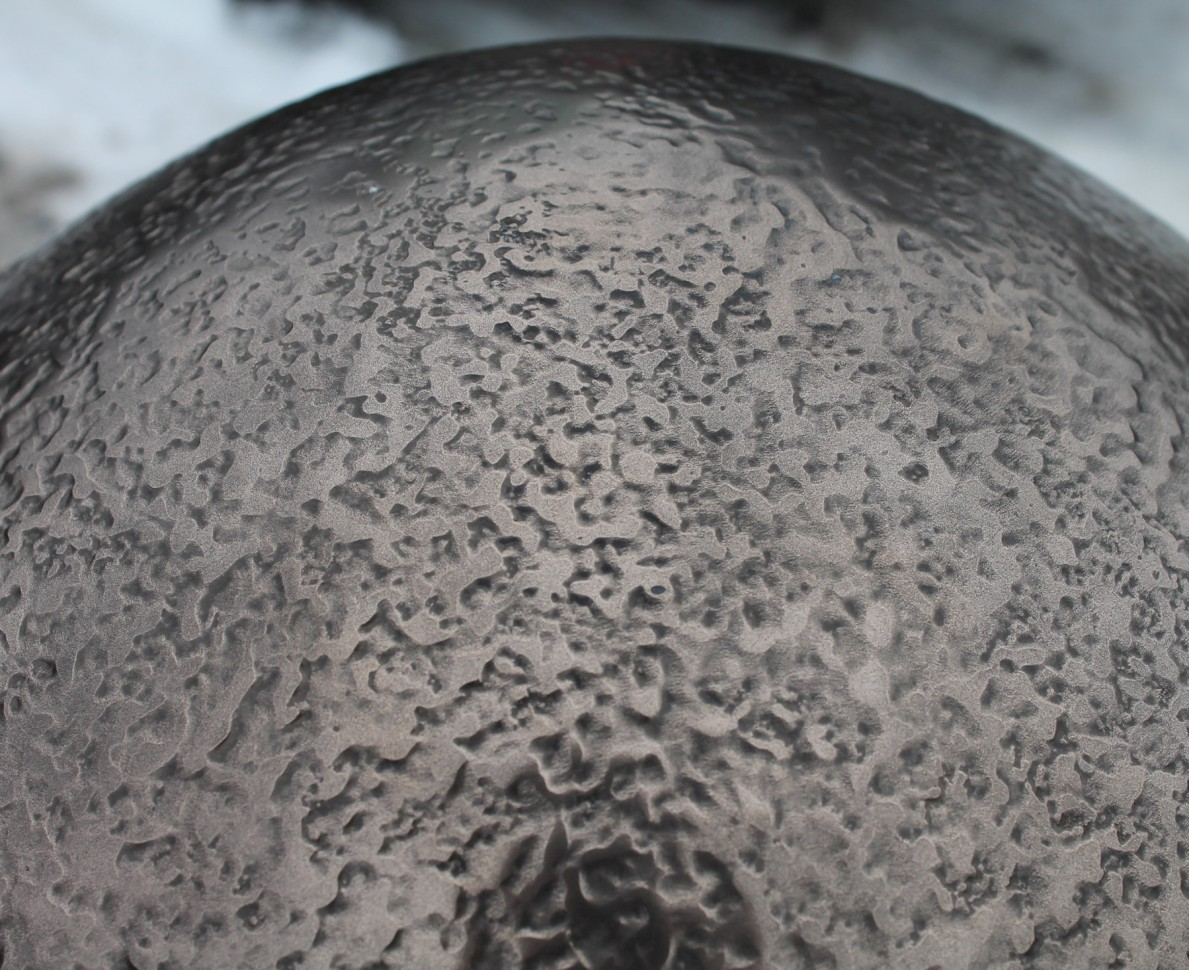 Close up of the patina and patternation of the bronze shell of the 2013 Big Egg Hunt Egg sculpture
