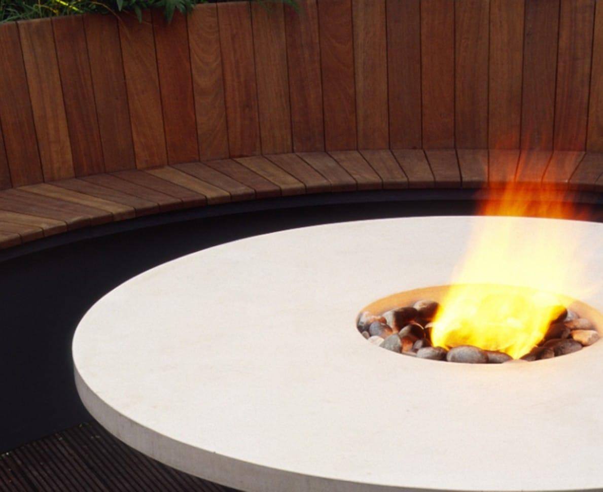 Curved seating and bespoke table with central flambeau for a Knightsbridge Roof Terrace