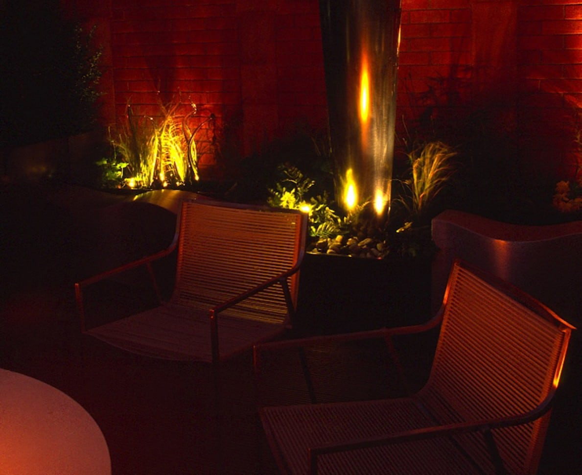 Knightsbridge Roof Terrace at night with lighting highlighting the plants and providing a feeling of warmth