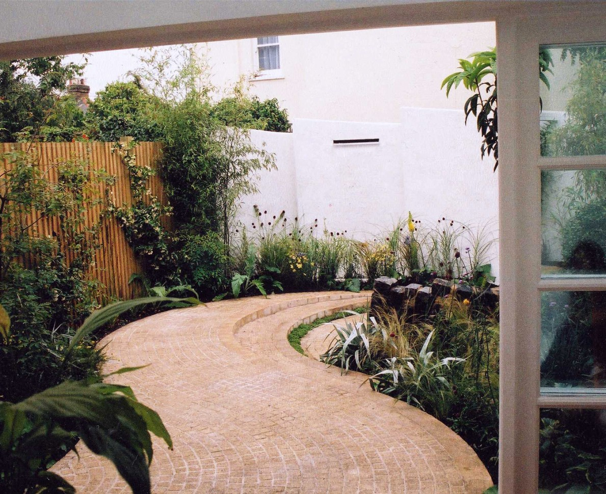Looking down the curved pathway from the house
