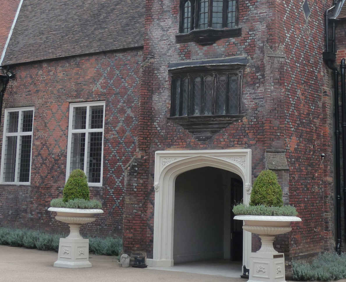 The beautiful entrance to Fulham Palace with planters either side of the grand porch