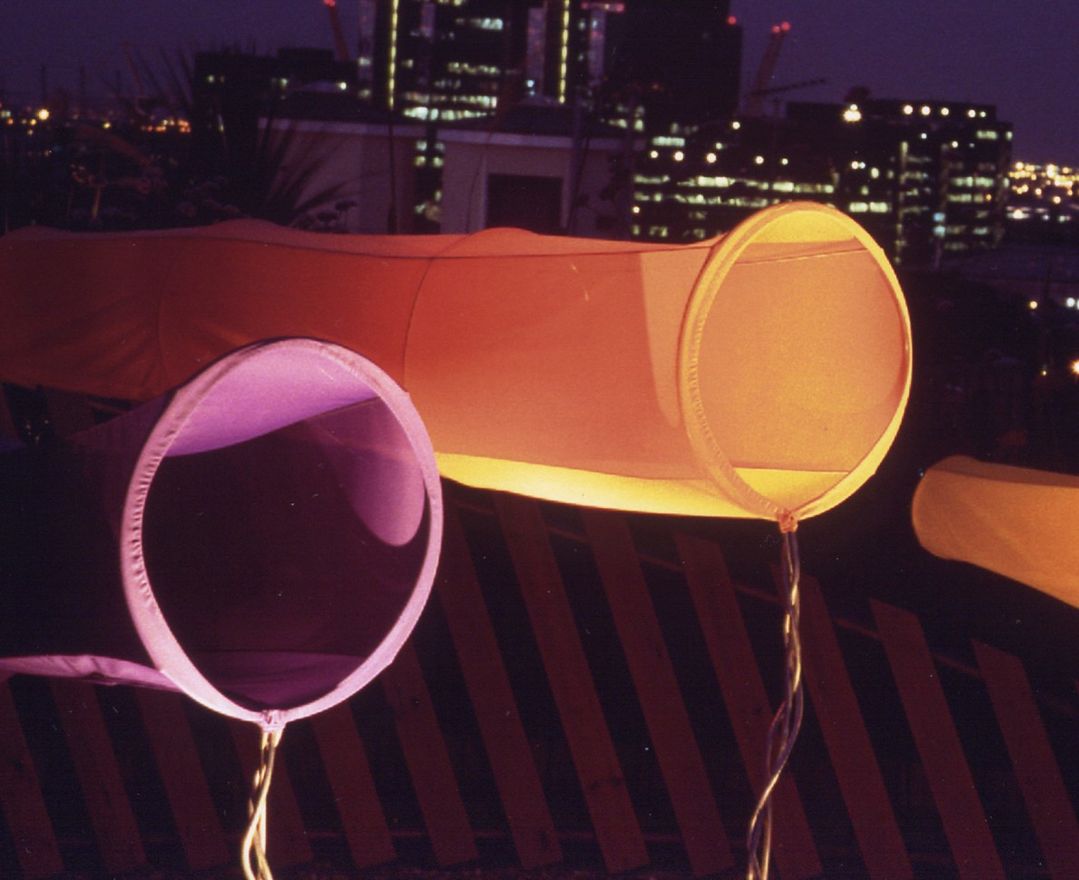 Close up of orange and purple windsock sculptures - roof terrace in Docklands