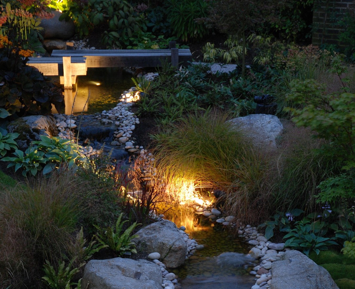 Water feature lit at night - Modern Japanese Garden