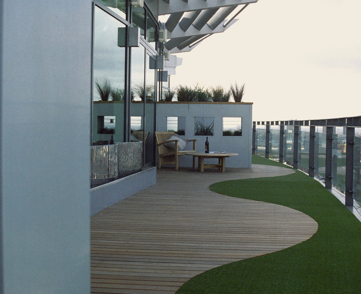 View down the terrace to show the artificial grass and apertures which break up the length of terrace