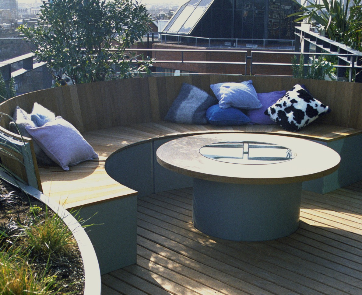 Seating area with comfy cushions and bespoke table - Pavilion Terrace