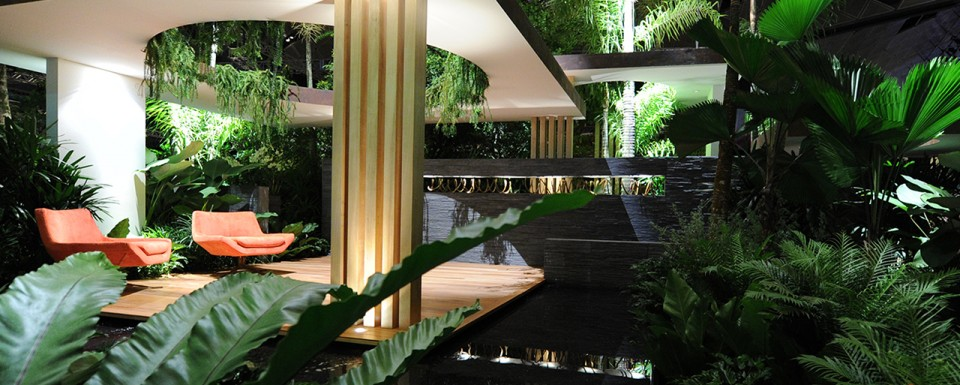 Semi open spaces with orange chairs under a shelter - Singapore Garden Festival 2012
