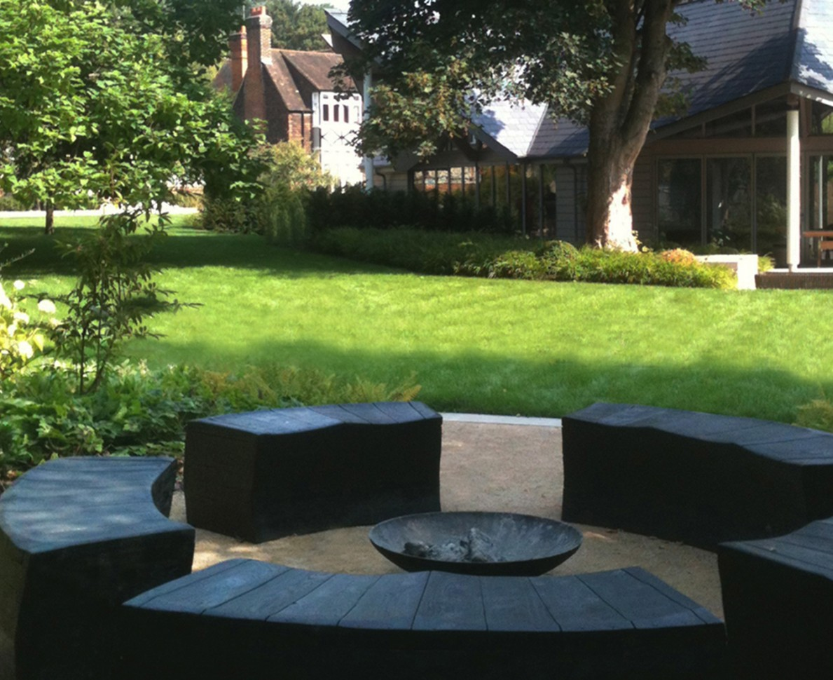 Modern circular seating area with firepit at the Box House