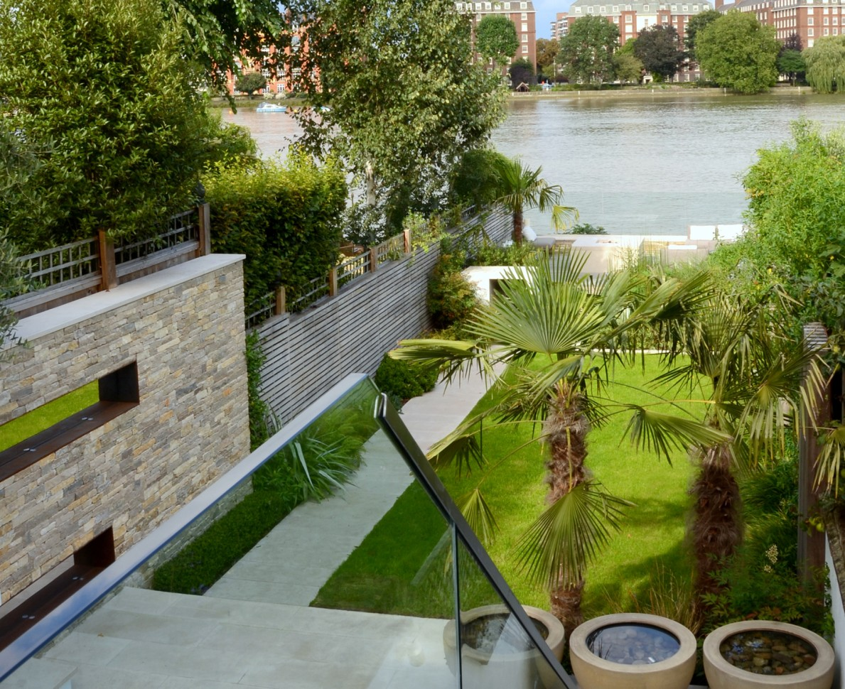 View of sleek sophisticated garden looking down to the river