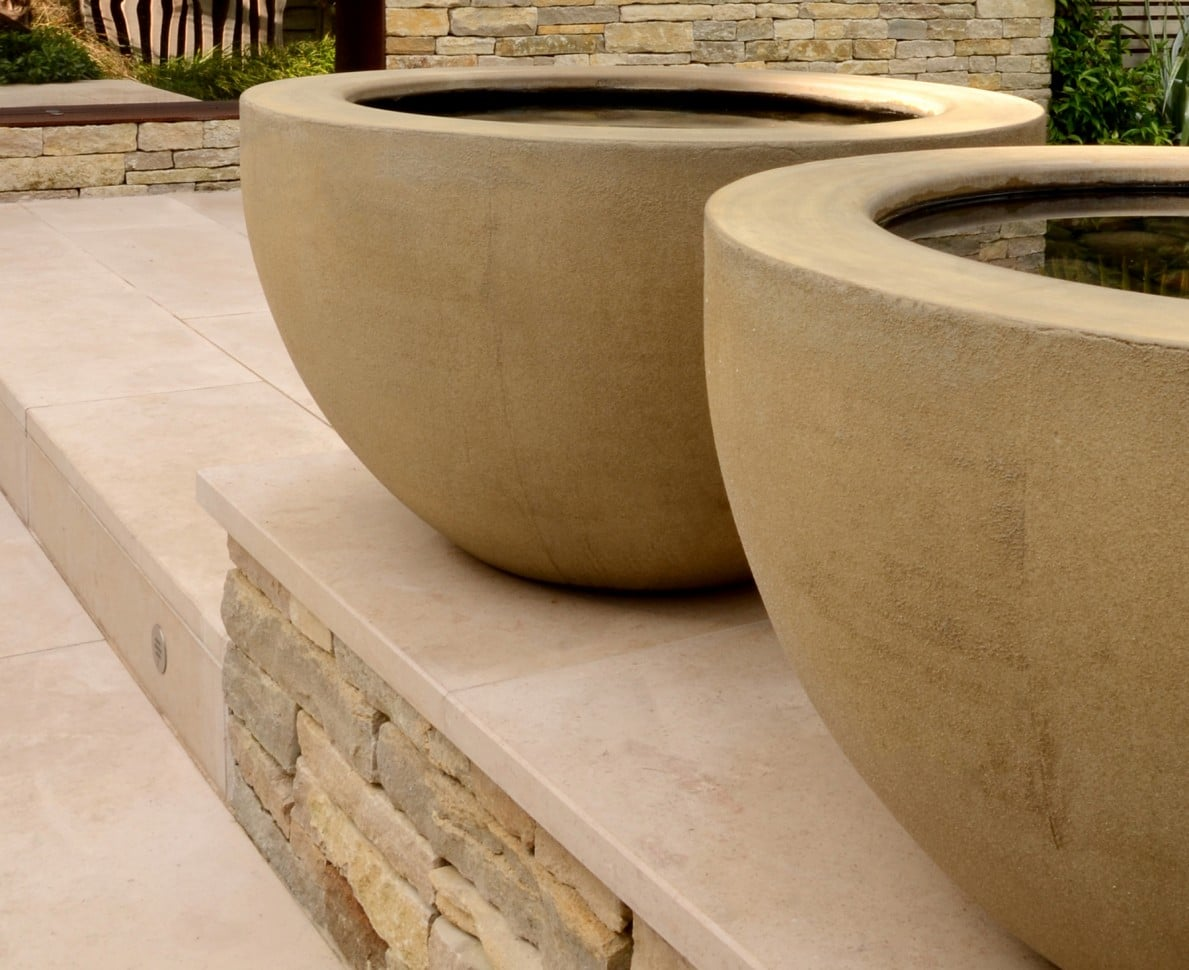 Two large concrete bowl shaped water features