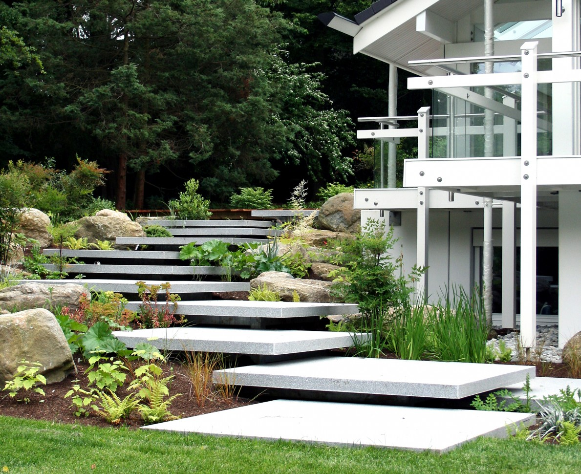 Concrete slab steps up the side of the Huf House