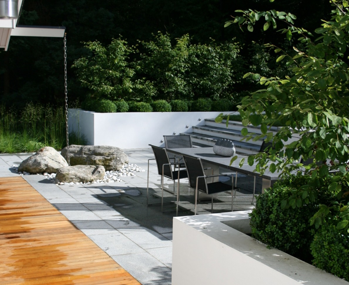 Wooden and concrete patio area with dining table