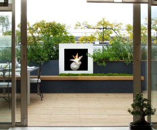 2010 Association of Professional Landscapers Principal Award winner - garden with sculptural plinth visible from bi-fold doors
