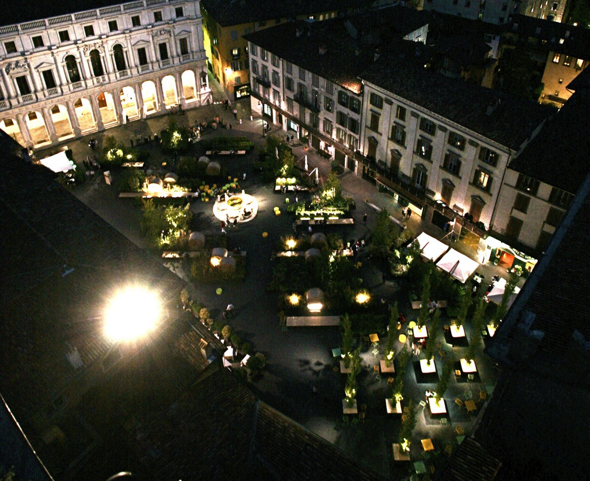 Aerial view of the piazza lit at night