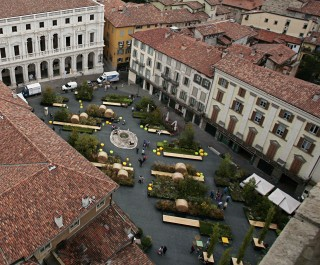 Overhead view of the Piazza Vecchia garden with haybales and benches