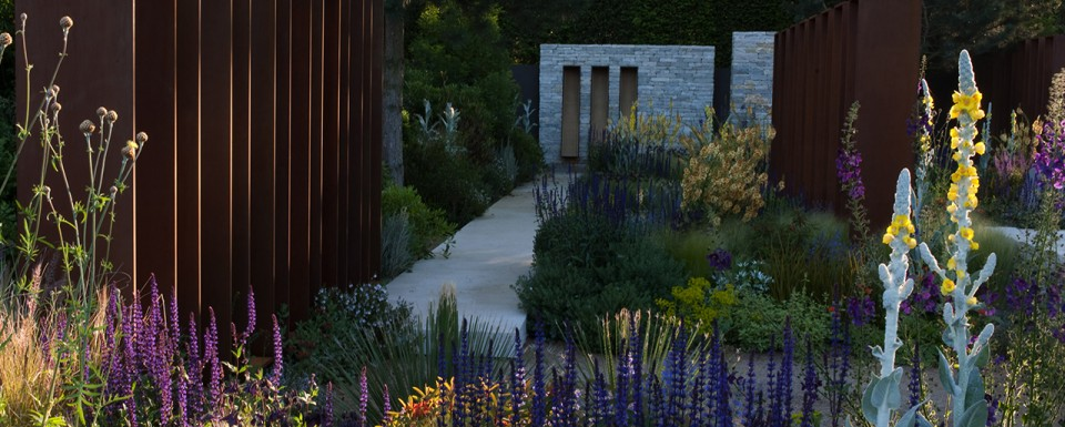 RHS Chelsea Flower Show 2010 view down the path towards the architectural stone wall