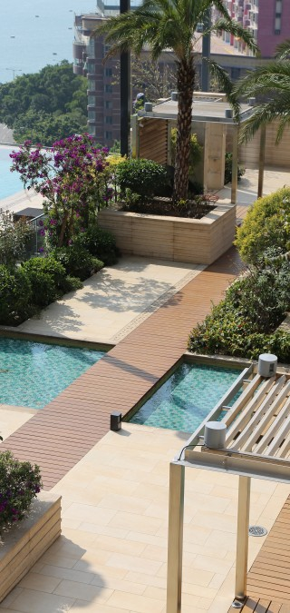 Westminster Terrace Overlooking Hong Kong Harbour Featuring Pathway Surrounded by Greenery And Pools