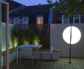 Moon Garden decking with table and chair and feature tree