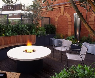 Outdoor Dining Terrace curved seating and round table with firepit in the centre