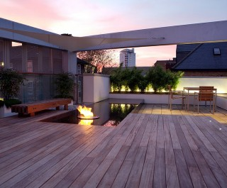Roof garden project - Decking with a feature pool, firepit and tiled seating area