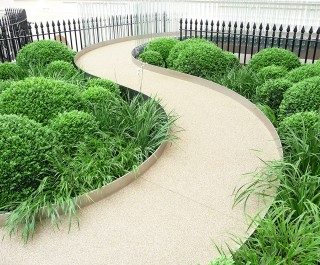Winding Path With Side Plant Beds Featuring Greenery