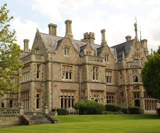Grand Building With Neat Lawn And Hedges
