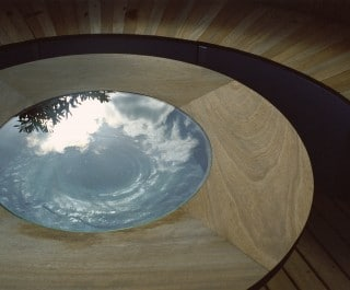 Bespoke table with water swirling inside it to reflect the light