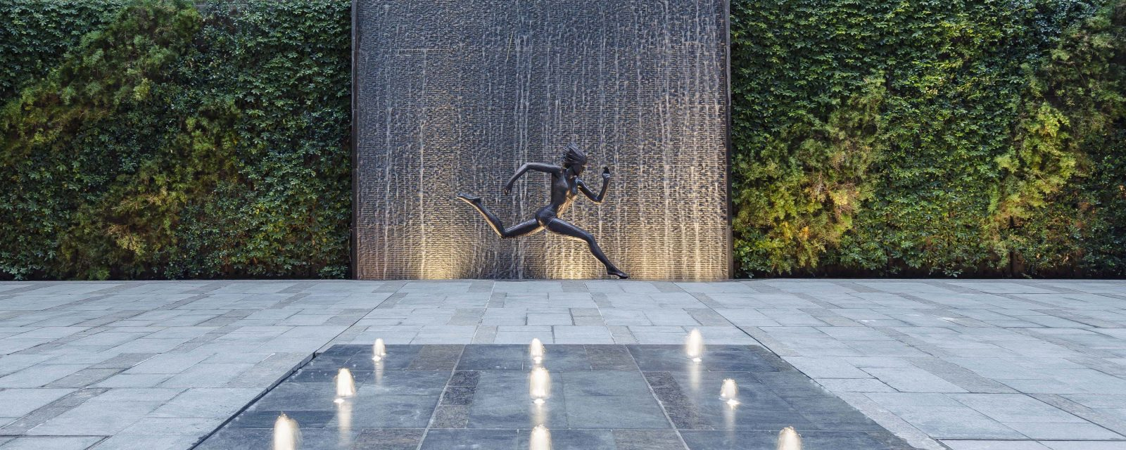 Female Statue Running With Waterfall Backdrop And Fountain Homatin Hillside by Garden Designer Andy Sturgeon
