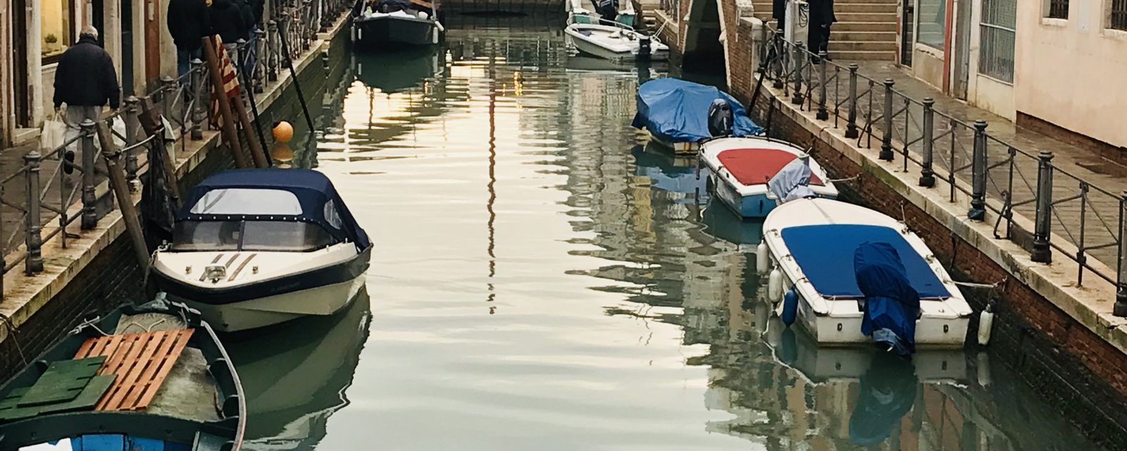Boats moored on the canals of Venice